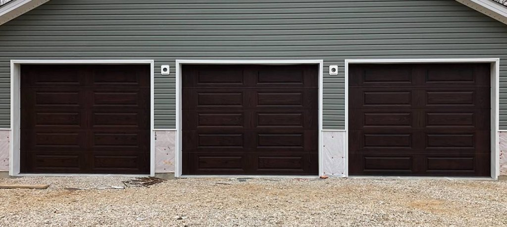 Three mahogany long-panel garage doors
